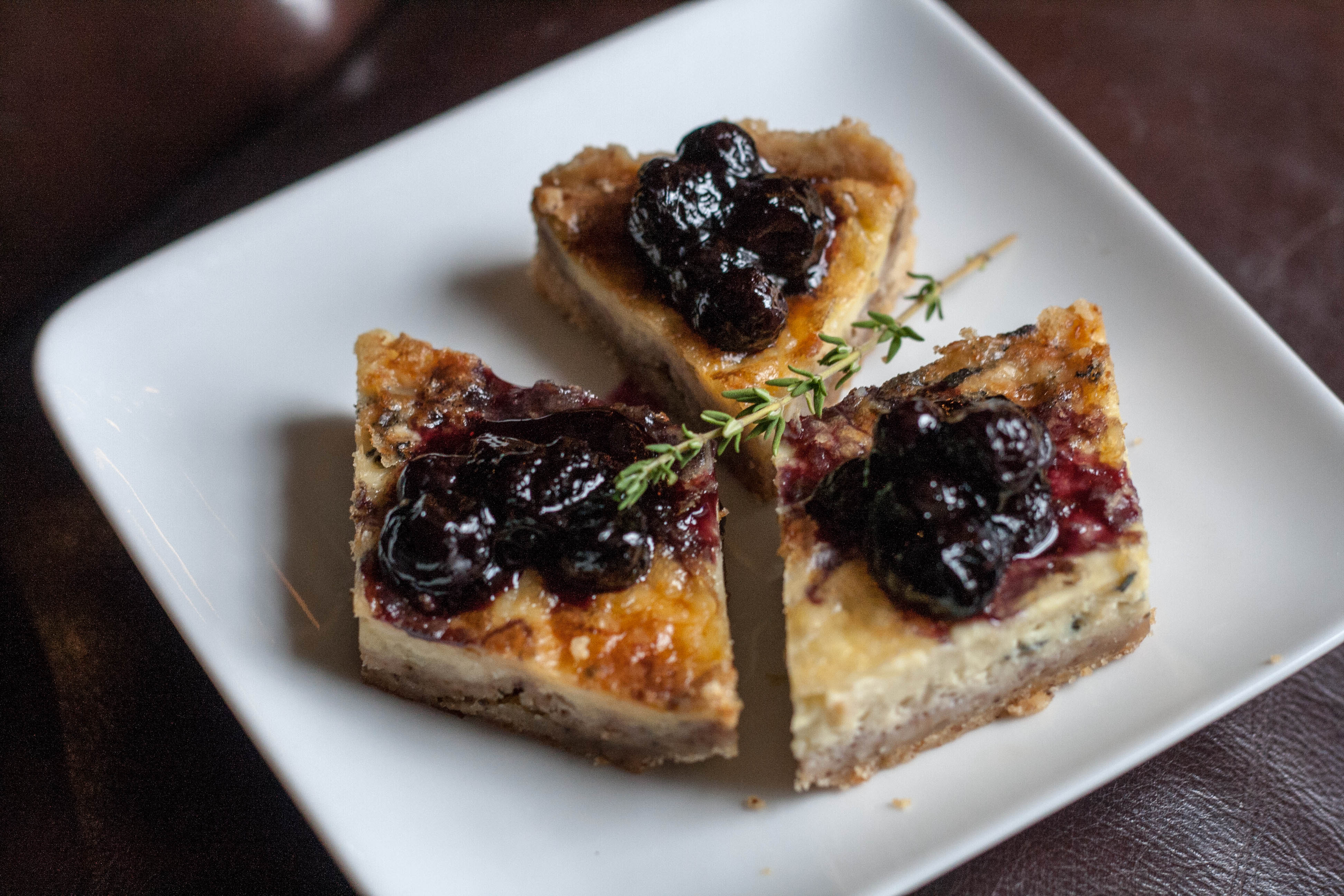 stilton tart with blueberry sage compote aerial