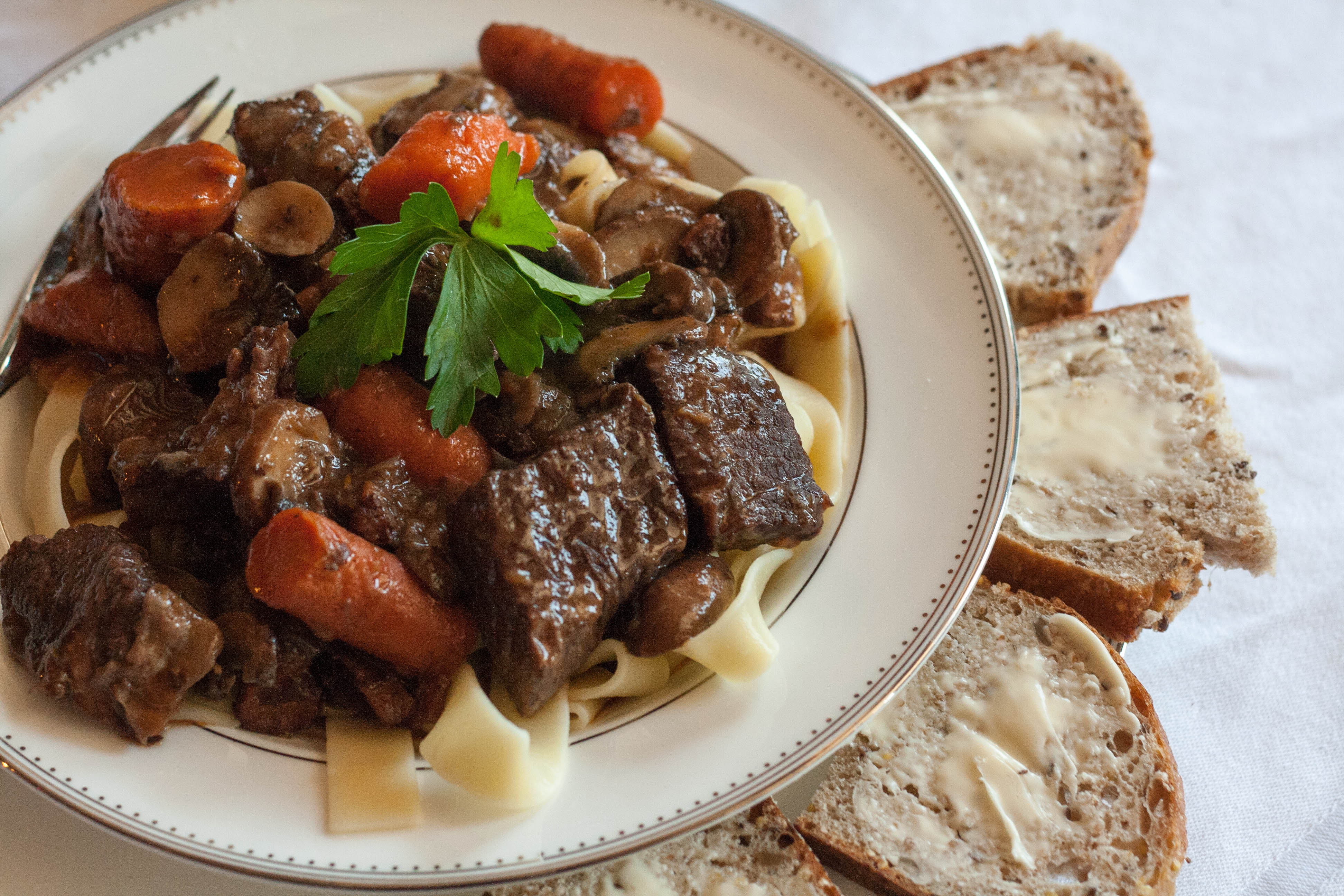 boeuf bourguinon with buttered bread