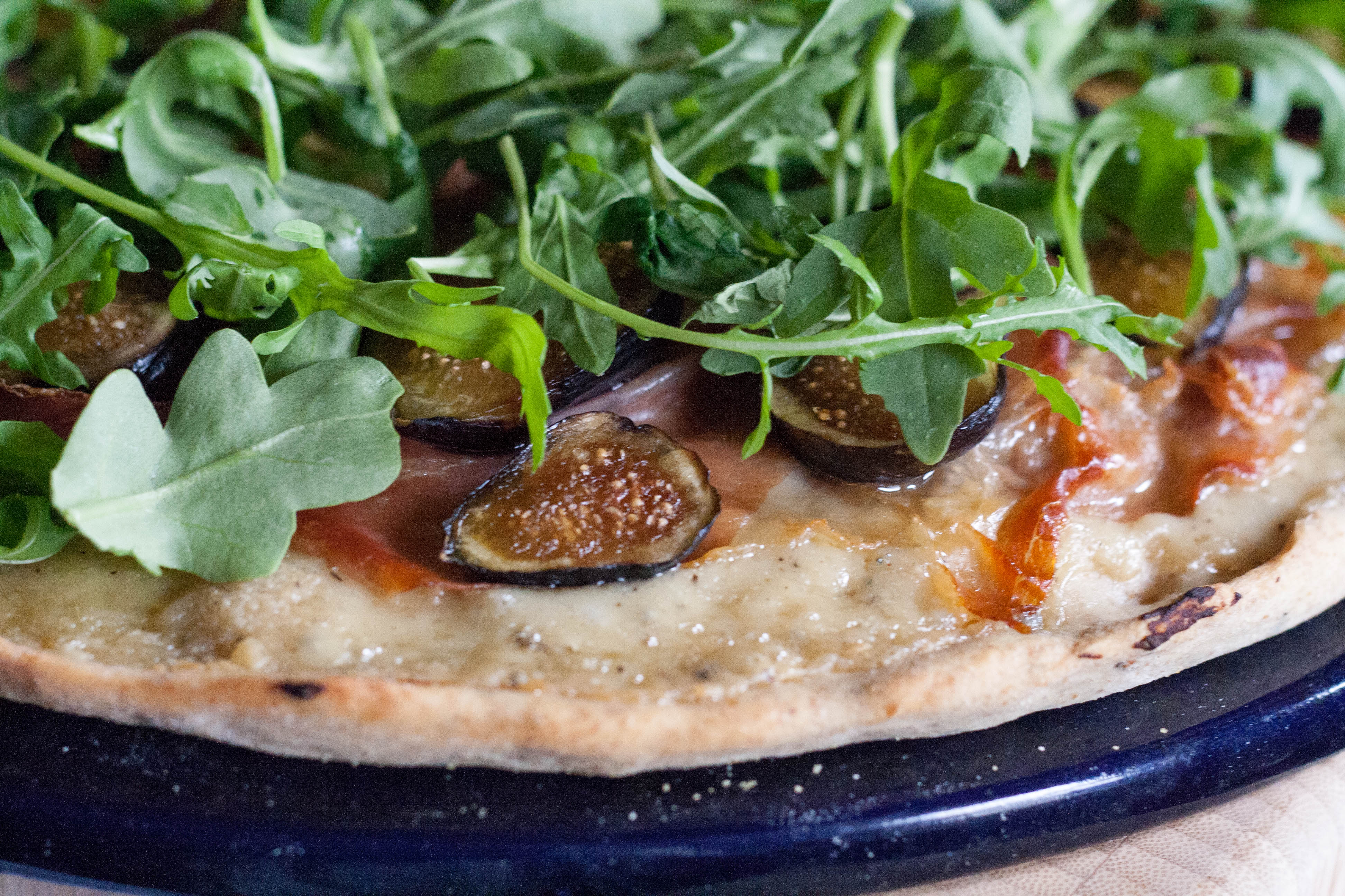 Fig and Prosciutto Pizza with Arugula topped