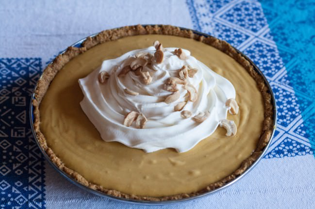 Pumpkin Butterscotch Pie with whipped cream and salted cashews