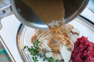 Elderflower Fennel Turkey Gravy on turkey slices