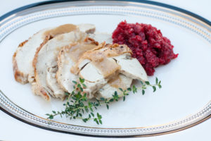 Juniper Brined Turkey Breast Roast sliced with relish